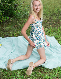 Extremely nice blonde teen is out on a picnic where she slowly removes her lingerie clothing to reveal her nipples.