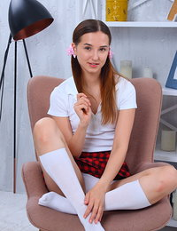 Stunning slim teen angel pulls off her skirt and cute underwear showing her beautiful naked body.